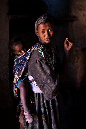 Tigrayan-woman-with-her-son-in-a-traditional-harness,-Tigray,-Ethiopia.jpg