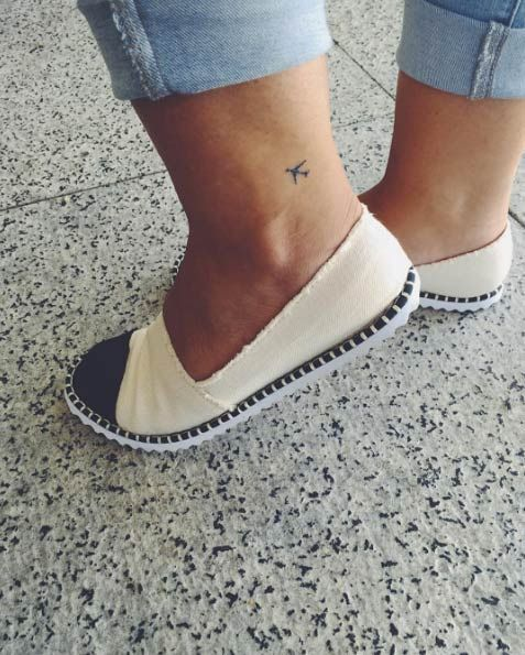Tiny plane tattoo on ankle via Gula de Viagem