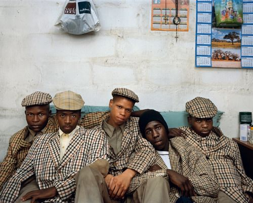 This photograph is of young men from the Xhosa tribe (from which Nelson Mandela came) on the day of their boys-to-men initiation ceremony in Mthatha, Eastern Cape. Photo by award-winning South African photographer Pieter Hugo. Hugo is known for documentary-style portraits of personal experiences in his native South Africa.