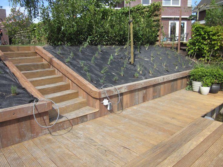Vlonder met talud waar grassen in geplant zijn tuin pinterest tuin met en zoeken - Ideeen deco trappen ...