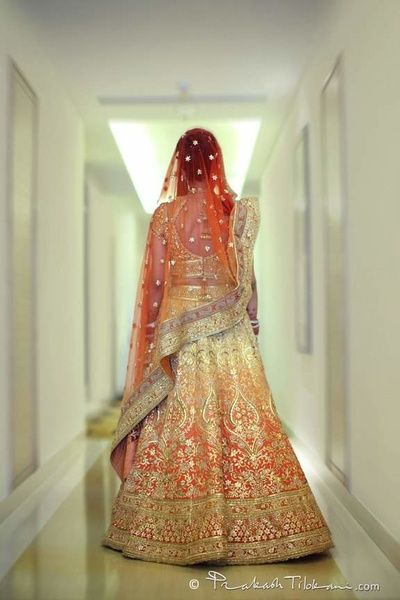 Bridal Lehengas - Tarun Tahiliani Ombre Lehenga | WedMeGood | Orange and Yellow Ombre Lehenga with Silver Gotta Work, Orange Net Dupatta  #wedmegood #indianwedding #indianbride #ombre #lehenga #bridal #taruntahiliani