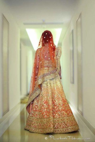 Bridal Lehengas - Tarun Tahiliani Ombre Lehenga | WedMeGood | Orange and Yellow Ombre Lehenga with Silver Gotta Work, Orange Net Dupatta  #wedmegood #indianwedding #indianbride #ombre #lehenga #bridal #taruntahiliani