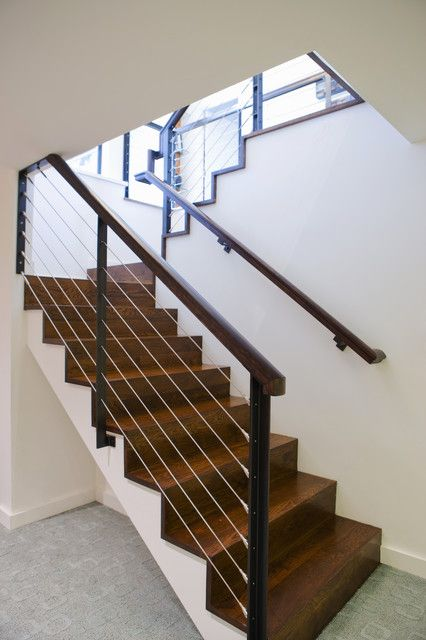 prefab stairs Staircase Modern with baseboards basement cable railing carpet texture dark floor wall