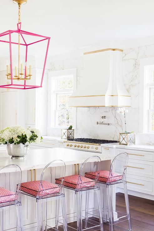 Laura Burleson Interiors - White and gold kitchen features white cabinets paired with Silestone quartz countertops and backsplash that resemble white marble.