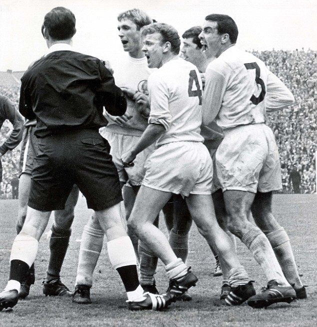 Referee Ken Burns is surrounded by Leeds players in an FA Cup semi-final against Chelsea in 1967