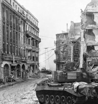 An American Pershing tank in the foreground and a German Panther in the background. Tank battle at the Cologne Cathedral