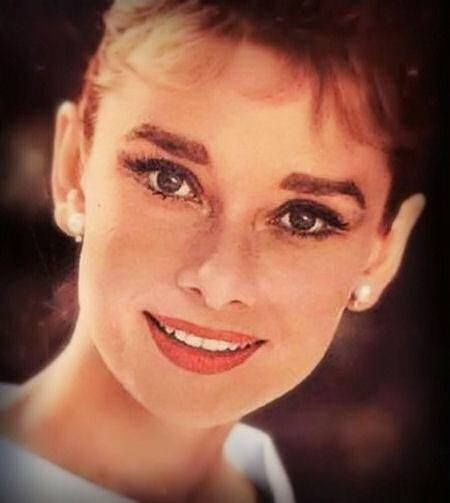 Audrey Hepburn. Thick shapely false lashes are better for her Kibbe style, and her colour season.