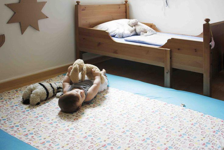 Tappeto gioco di design turchese per neoanti e bambini