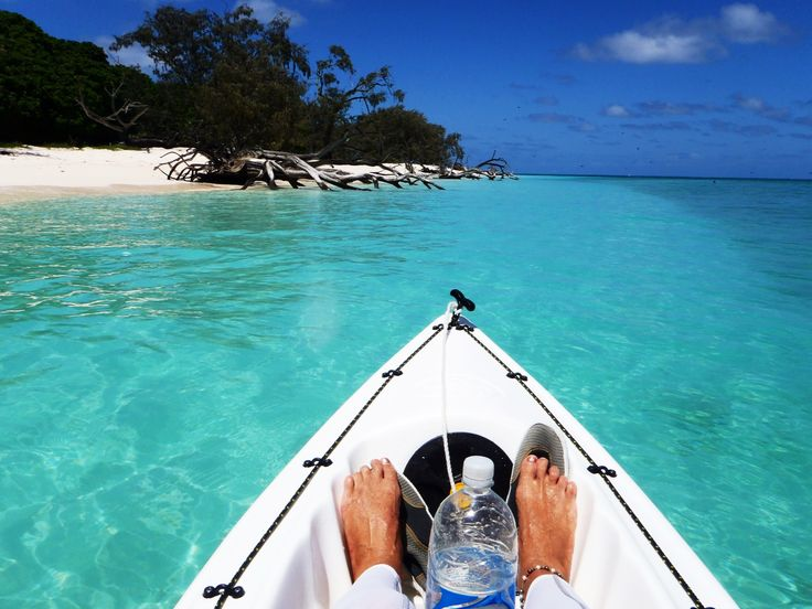 Paddling my kayak around Lady Musgrave Island, Great Barrier Reef.