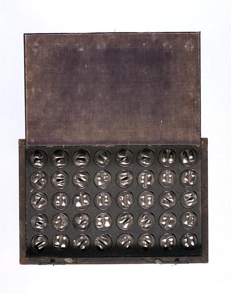 Box containing 40 silver dental molds used at a metal health hospital Lakeside Mental Hospital Ballarat Victoria Australia circa 1910. Dental molds were used to make an impression of a patients teeth in order to make a customised dental replacement.  Collection: Museum Victoria