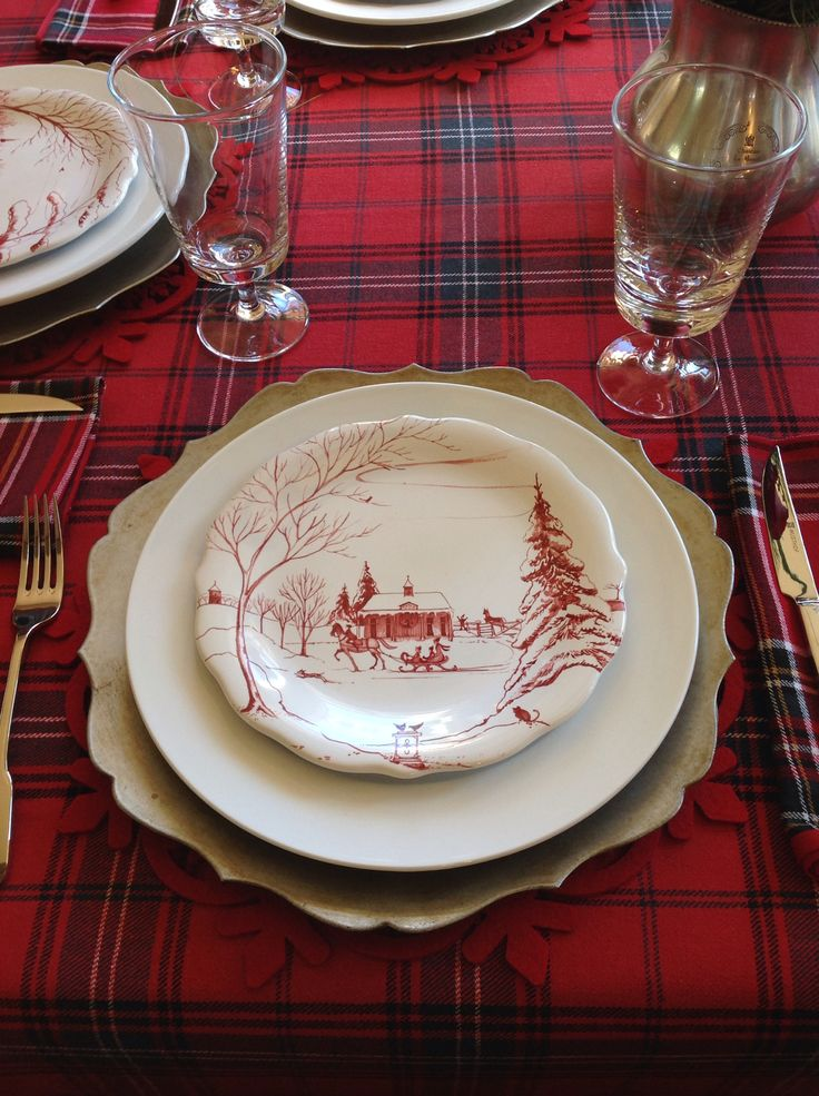 Lovely Christmas table setting with Christmas plate and tartan tablecloth