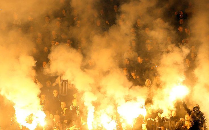 Partizan soccer fans light torches during a Serbian National soccer league derby match between Partizan and Red Star, in Belgrade, Serbia