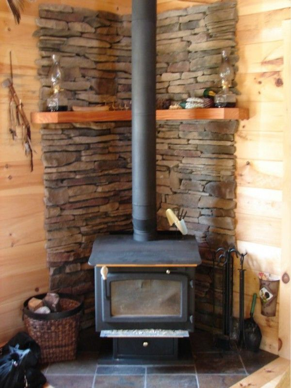 Image of Wonderful Wood Stove in Small Cabin with Wicker Log Baskets for Fireplaces