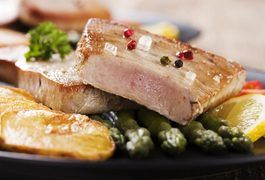 Yellowfin tuna is a delicacy often enjoyed raw in sushi, but it is also excellent when cooked. Yellowfin tuna is a member of the mackerel family that is high in omega-3 fatty acids, which are good for your heart because they help lower levels of low-density lipoproteins, or LDLs, in your bloodstream. Baking yellowfin tuna allows it to retain its...