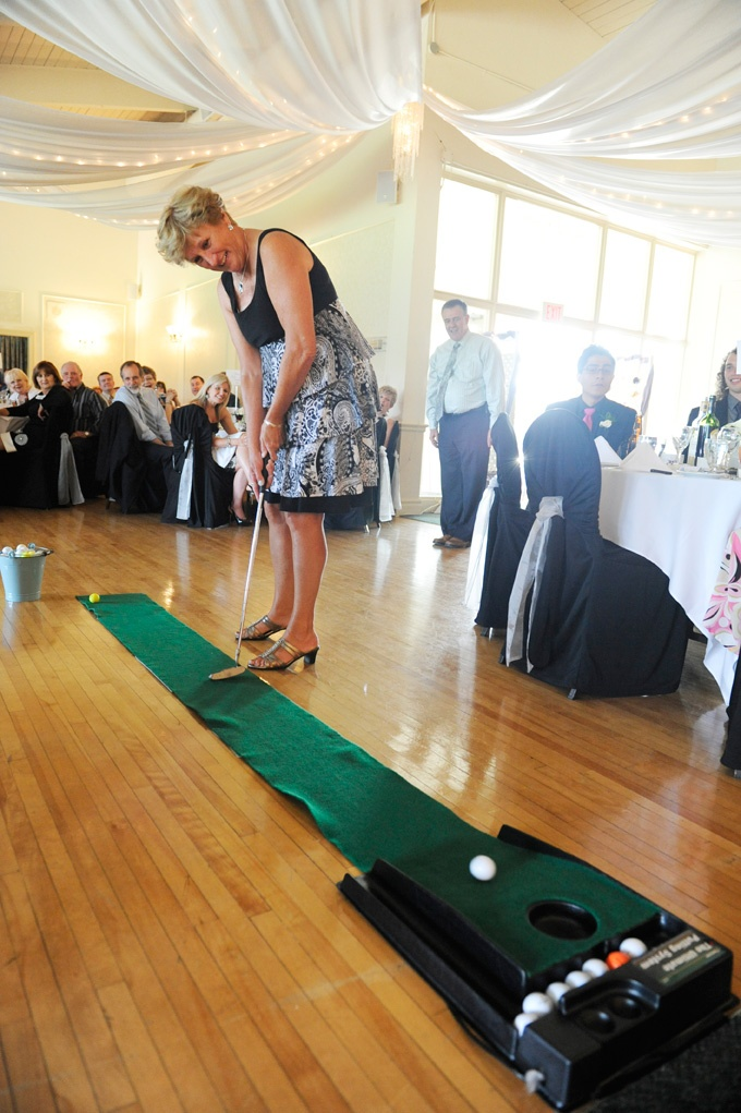 Mini golf game, wedding, reception, kiss the bride, copyright www.tamimcinnis.com