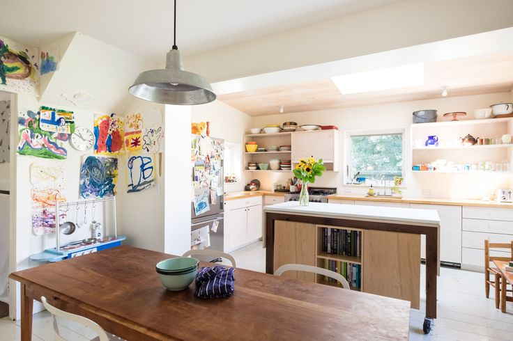 """""""Nick designed and built a modern """"box"""" scabbed onto our traditional island cottage. The new, light filled space turned the kitchen into a studio/office for me and created a family gathering place. Free Standing Island – Nick Waldman Studio."""