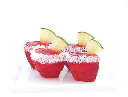 Learn how to make easy Jello shooters and strawberry margarita jello shooters. Start by creating a well in the center of your strawberry and mixing maragarita mix with Jell-o