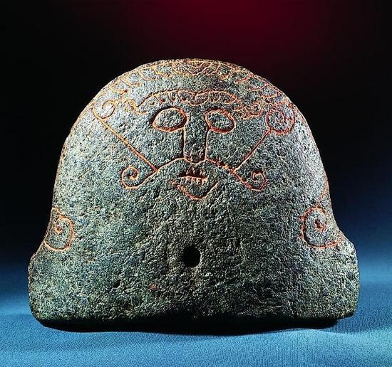 Viking Age. Bellows protector of soapstone found in Snaptun in Horsens Fjord, height 20 cm. It originates probably from Norway or southern Sweden and is dated to ca. 1000