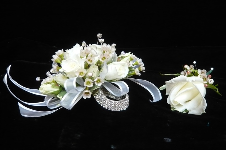 White spray rose #corsage and #boutonniere for #prom by Emil J Nagengast Florist, Albany, NY