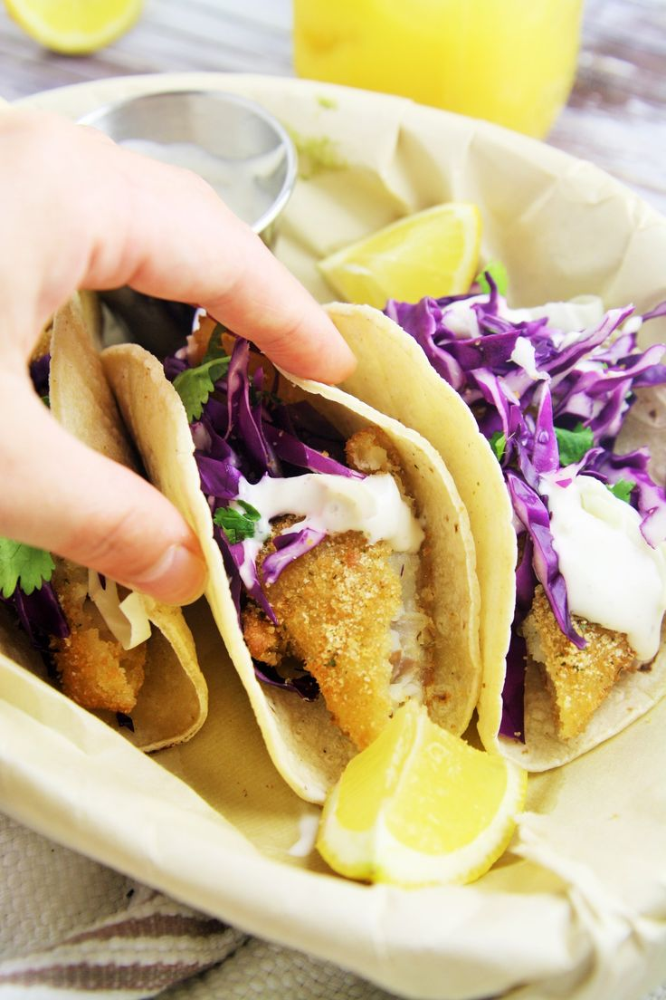 Crispy, tender pieces of fish, crunchy cabbage slaw, and zesty lime crema folded into a warm corn tortilla — these are the ultimate fish tacos for Taco Tuesday or any day of the week! Every Friday, there's a popular food truck that stops outside of my office building with long lines of people waiting patiently …