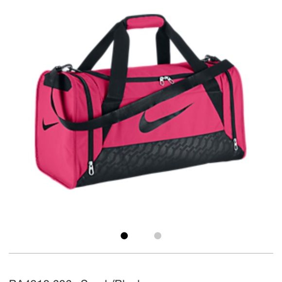 NWT's Nike Women Duffel bag NWT's Nike Women Duffel bag. Water resistant, heavy duty fabric protects your items. Dual zip main compartment is perfect for workout gear, while a separate wet-dry shoe compartment offers versatility. Side zip compartment adds extra storage possibilities. Large shoulder strap keeps things comfortable, while durable handles offer an extra carrying option.  Also cam be used as a overnight bag. Nike Bags