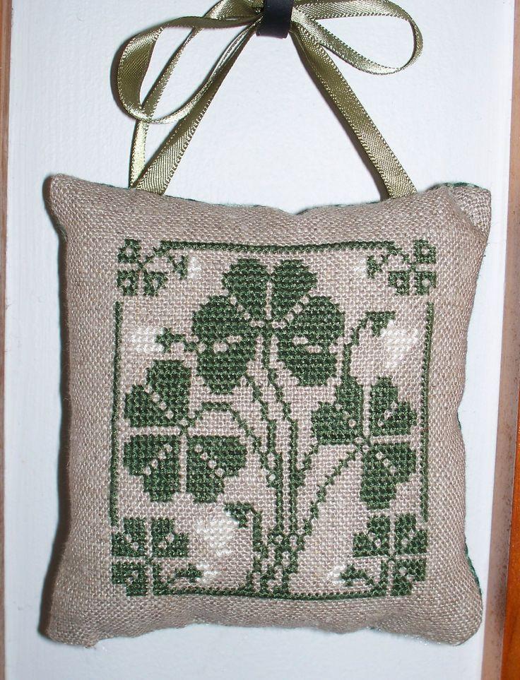 Cross stitched ornament. Design by Prairie Schooler.