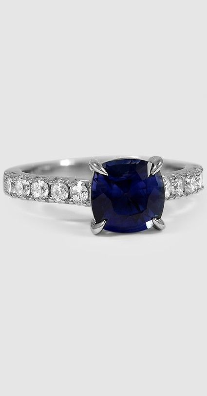 This mesmerizing deep blue sapphire ring features French pavé diamonds along the band.
