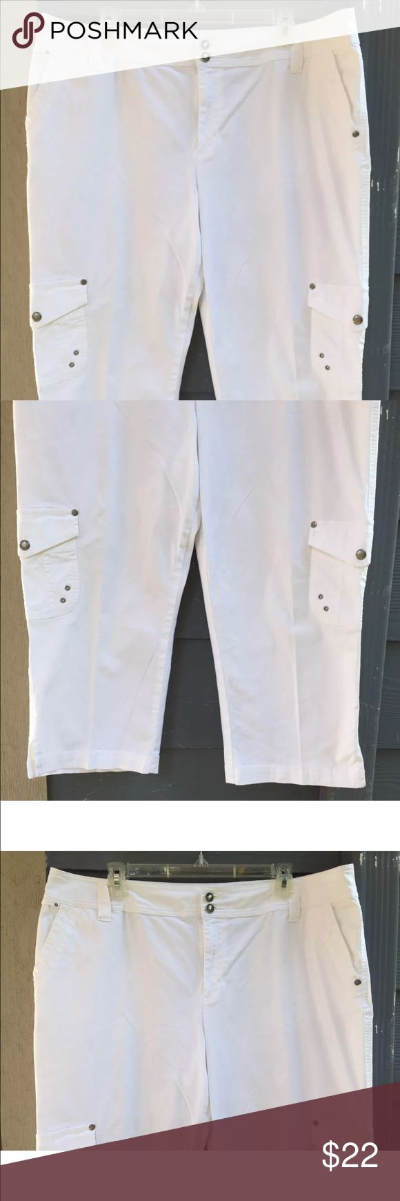 """TRIBAL WOMEN'S CAPRIS CARGO PANTS STRETCH SZ 16 TRIBAL WOMEN'S CAPRIS CROPPED CARGO PANTS WHITE STRETCH 6 POCKETS SIDE SLITS SIZE 16   NEW WITHOUT TAG!  Measurements laying flat approximate: Waist 19 1/2"""", hips 23"""", crotch 13"""", inseam 22"""", length 32"""".  THESE GORGEOUS PANTS HAVE BEEN A DISPLAY AND TRIED ON AND OVERAL ARE IN GREAT CONDITION!  NOTE:  PLEASE REVIEW MEASUREMENTS CAREFULLY BEFORE PURCHASING THIS ITEM SINCE SIZES SOME TIMES ARE DIFFERENT FROM BRAND TO BRAND. Tribal Pants Capris"""