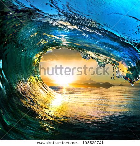 stock photo : rough colored ocean wave falling down at sunset time