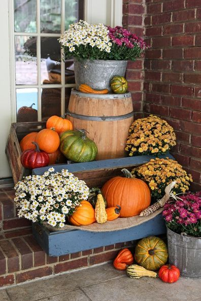 business in the front party in the back fall porch decor for all, porches, seasonal holiday decor, Pumpkins and mums inside an old blue trunk and on top of a whiskey barrel