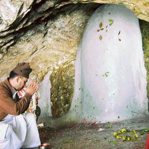 Lord Shiva Amarnath-Ji, natural ice lingam, in natural cave temple, Kashmiri Himalayas, India.