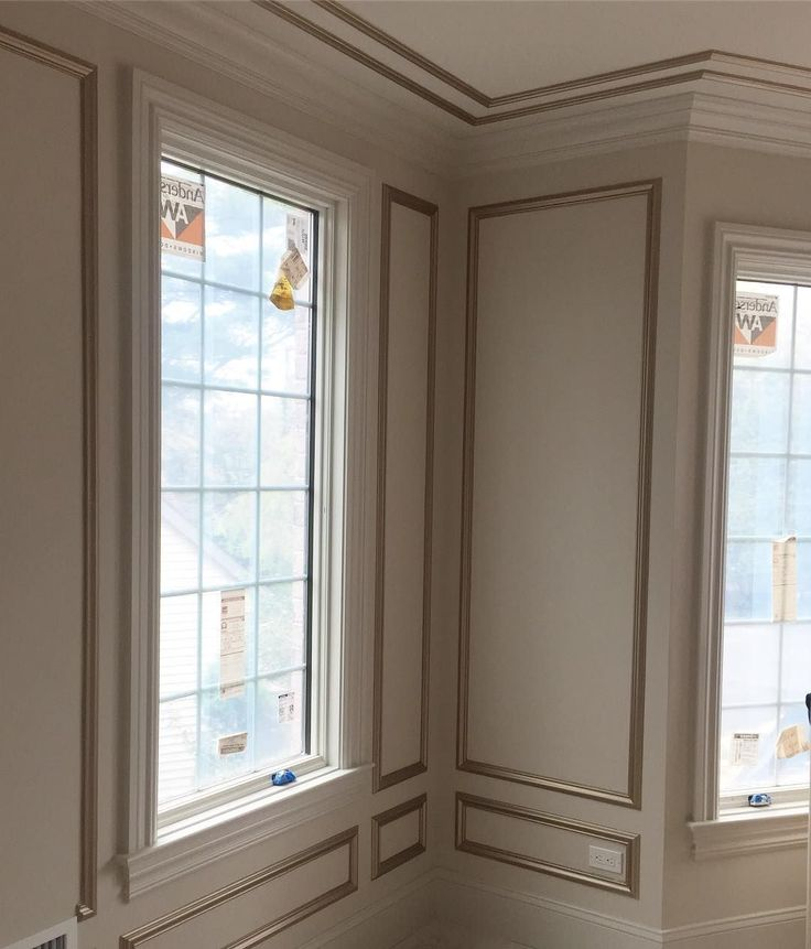 Beautiful living room panel trim painted with Champagne Metallic Paint by Modern Masters | Rock Solid Builders / AH Design Group
