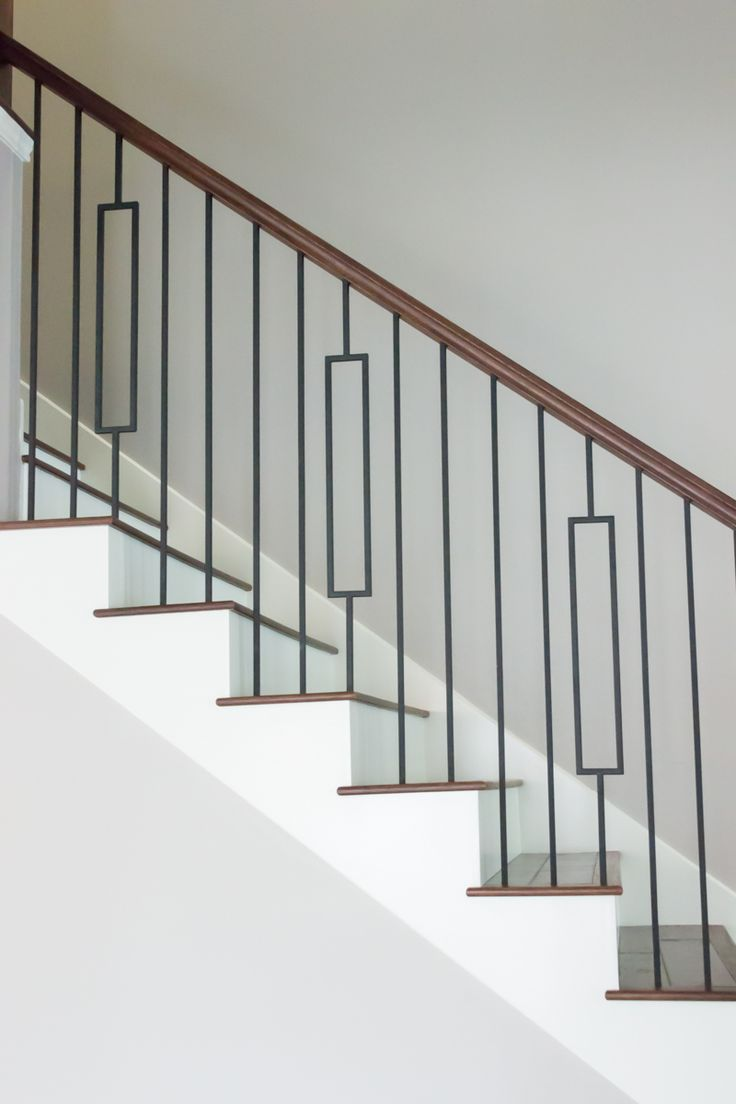 This staircase uses high quality wrought iron balusters to create a unique contemporary style design. Featured are the single rectangular balusters (16.6.3) and the plain square bars (16.2.1). These balusters are paired with modern wood components such as our 4000 blank series newel post, square newel cap, and the 6002 handrail. We supply a variety of stock parts, custom material, and exotic wood. Click the image for more information.
