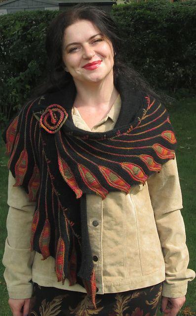 http://www.ravelry.com/patterns/library/holidays-season-shawl