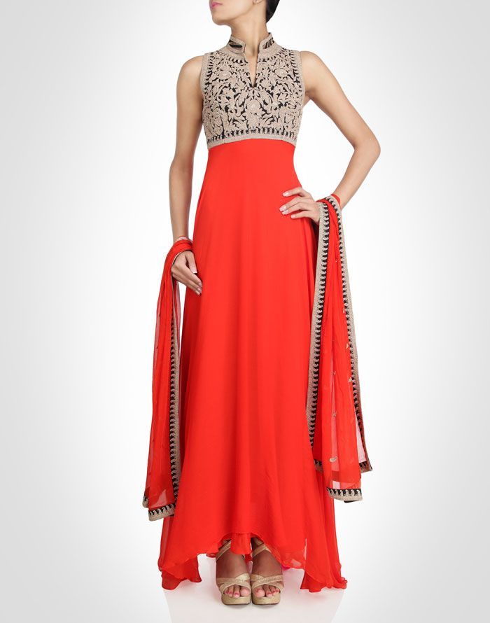 Orange anarkali with a flowy silhouette.