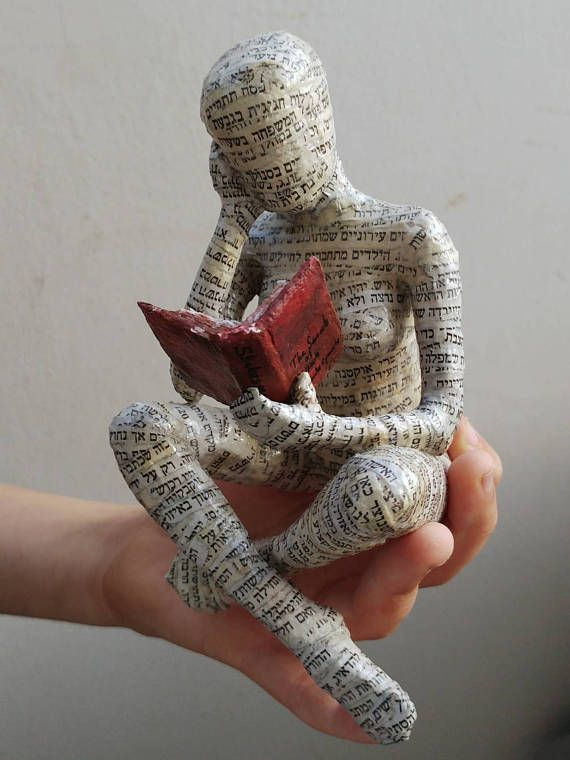 Papier mache reading woman. This is a custom made reading woman. She is a variation of another sitting woman I have in the shop. I have made slight changes in each figure, sono two are exactly the same. The purpose here was to make a delicate gift. Something special to someone that loves art and reading. It can sit on a bookshelf. The armature is wire and newspapers. The cover is newspaper. Cleaning - one can clean it with a wet towel. I looks delicate but it doesnt break easily. Back to ...