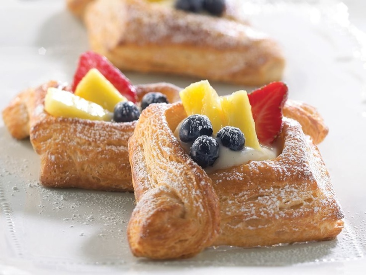 New for summer: Fresh Fruit Pastry!  Flaky pastry crust filled with pastry cream and topped with fresh strawberries, fresh blueberries, fresh pineapple and powdered sugar.