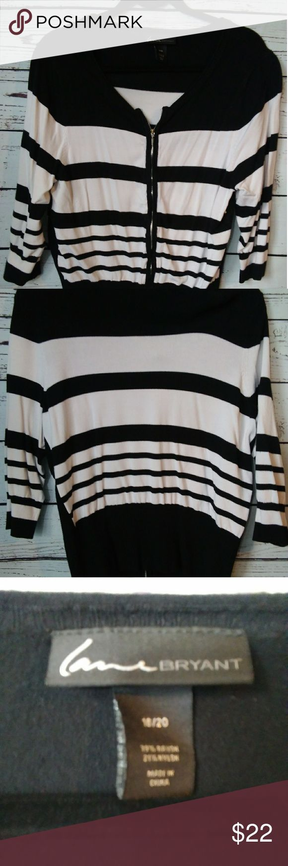 Lane Bryant black and white  sweater size 18/20 Lane Bryant black and white sweater with zipper on front. This is in great condition. Size 18/20 mid level sleeves.  Length 20 inch Shoulders 19 Sleeves 18 inch Lane Bryant Sweaters Cardigans