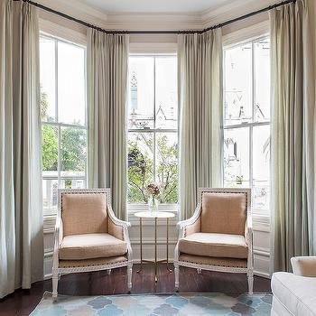 Curtains On Bay Windows - Use long floor to ceiling panels to frame each window - simple/plain fabric thats easy to clean is best!