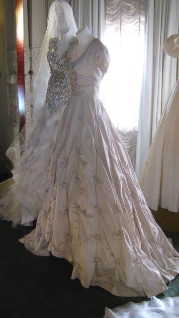 Wedding dress worn by Jeannie Corlett (Melbourne) in 1957. Peau de soie silk, beads, diamantes. Made by La Petite.
