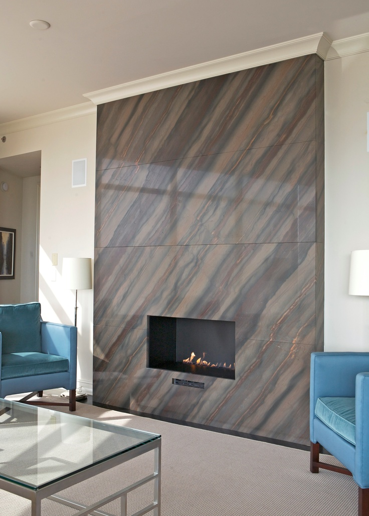 Elegant Brown Fireplace Surrounding For A Focal Point In The Living Room.  Elegant Brown Can Be Found At Amsum And Ash.