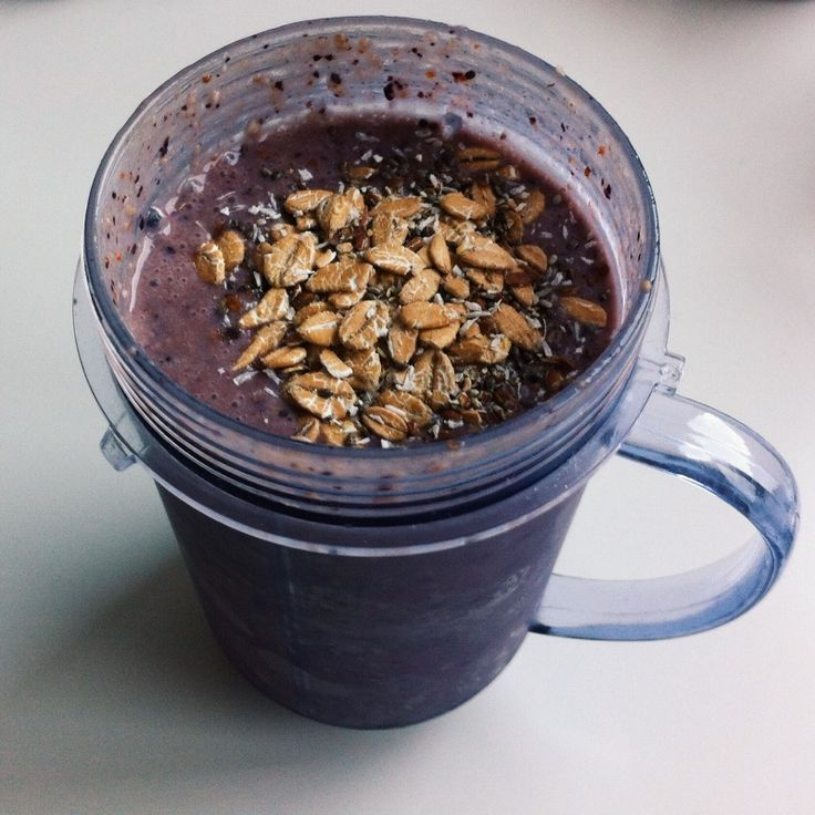 frozen blueberries, banana, soy milk, water and peanutbutter topped with coconut, chia seeds and spelt | breakfast