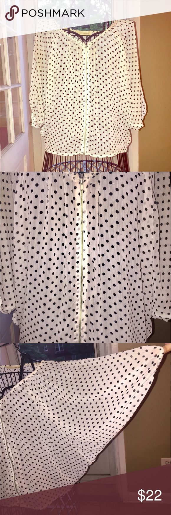 Zip-front polka dot top This top is loose and flowy, non-binding & great for those warm, breezy days & nights.  Shirt features 3/4 batwing sleeves.  The size tag is no longer attached, but I'd say this would fit a size M or L without a problem. Sans Souci Tops