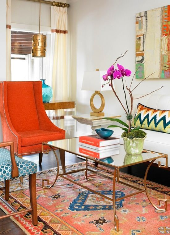 Leigh Mowry of Olive Interiors | eclectic transitional living room with brass mirror coffee table