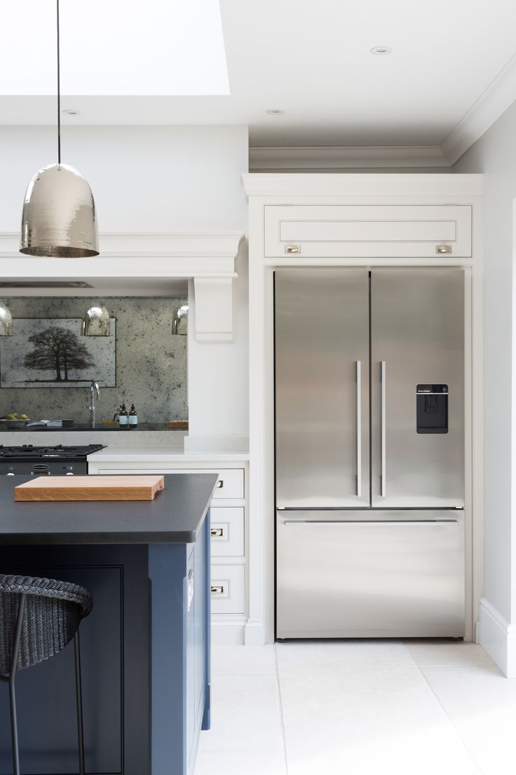Contemporary Family Kitchen, Chelmford, Essex - Humphrey Munson Kitchens - Dark blue island, grey cabinetry, metallic lighting, american fridge freezer - french door opening.