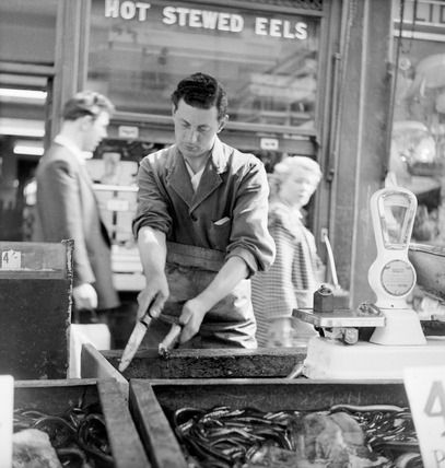 A Chapel Street Market eel stall, outside Manze's: 1955. By Henry Grant.