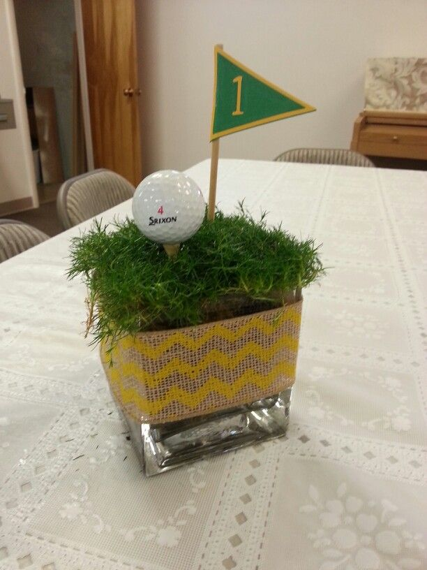 "Easy peasy. Turf (if it's not sod time we'll use wheat grass and cut it short), vase, ball, tee and flag number. Note-these are probably 4"" cubes. We could go up to 6"" cubes or do multiple heights. More"