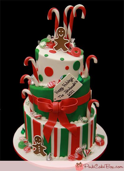 Christmas Candy Cane & Gingerbread Cake    The next tier is covered in green fondant with a red center band and bow. The final tier is covered in white fondant with red and green stripes. Flavors and fillings included chocolate with oreos and cream buttercream, vanilla with raspberry chambord buttercream and smores.
