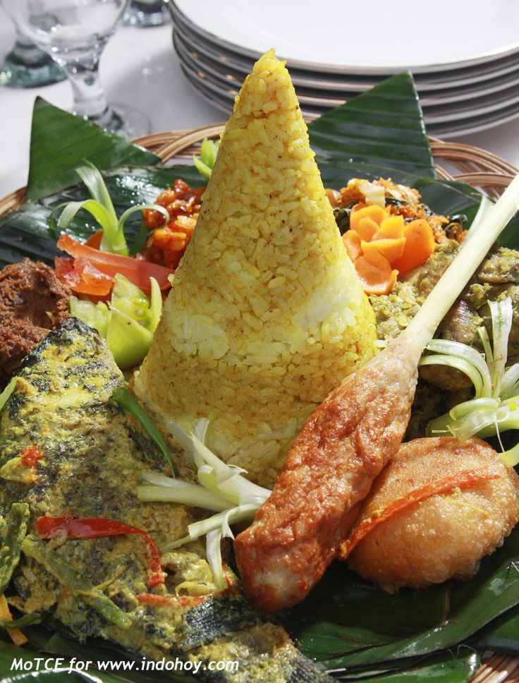 Festivities MUST-HAVE | Nasi Tumpeng | The color yellow symbolizes wealth, abundance and high moral. This kind of Tumpeng is usually used as substitute of a birthday cake!