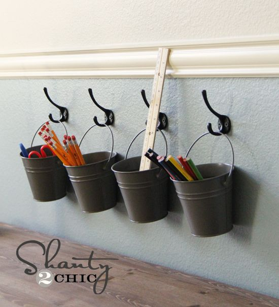Spray paint metal buckets and hang on wall with hooks - they look great and are a good solution for storing all sorts of little items in the kids' rooms, office, kitchen, etc.